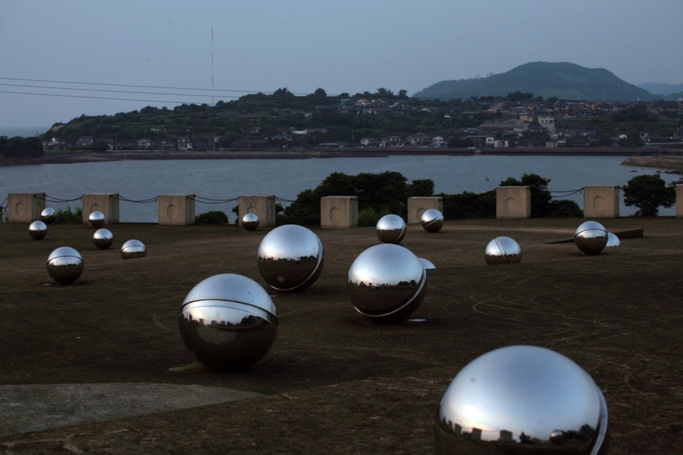 A memorial to victims of mercury poisoning overlooking Minamata Bay.